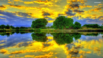 Golden Clouds Green Trees Lake wallpapers and stock photos