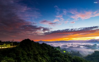 Foggy Vale Hills Clouds Sunset wallpapers and stock photos