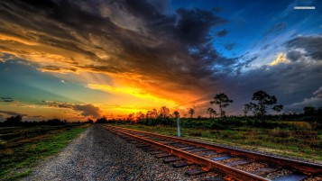 Wonderful Sunset Over Tracks wallpapers and stock photos