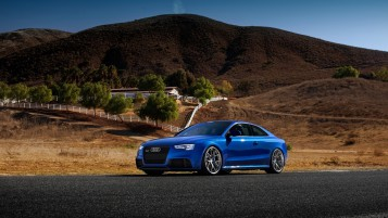 Blue Audi RS5 Side Angle wallpapers and stock photos