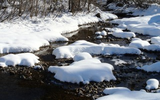 Thick Snow & Rocky River wallpapers and stock photos