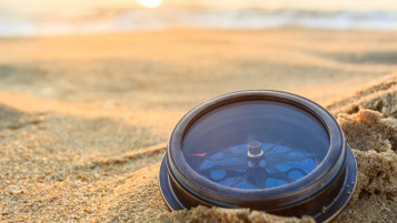 Compass in the Sand wallpapers and stock photos