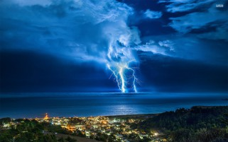 Thunder Storm Coastal Town wallpapers and stock photos