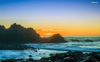 Ocean Black Rock Orange Sunset wallpapers and stock photos