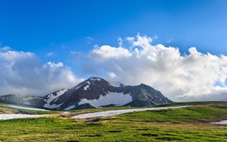 Mountain Field Snow Clouds Sky wallpapers and stock photos