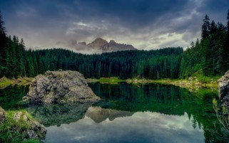 Dark Green Forest Lake Rocks wallpapers and stock photos