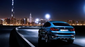 Blue BMW X4 in Dubai wallpapers and stock photos