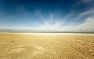 Yellow Sand Desert Blue Sky wallpapers and stock photos