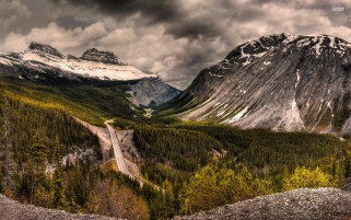Rocky Mountains Forest Road wallpapers and stock photos