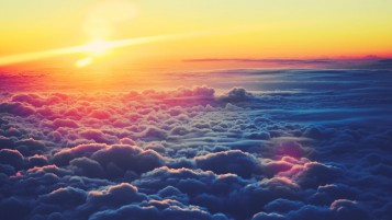 Random: Sunrise Above Fluffy Clouds