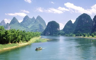 Mountains Wide River Boat wallpapers and stock photos