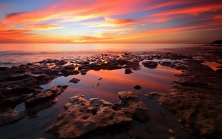 Nice Ocean Rocks Orange Sky wallpapers and stock photos