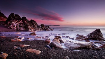 Ocean Rocks Coast Pink Sky wallpapers and stock photos
