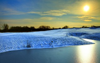 Snowy Hills River Yellow Sunny wallpapers and stock photos