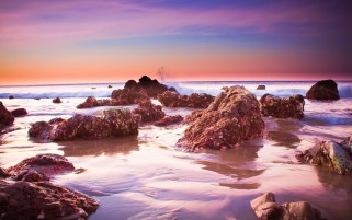 Ocean Rusty Rocks Pink Sky wallpapers and stock photos