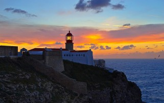 Ocean Light House Cliff Sunset wallpapers and stock photos