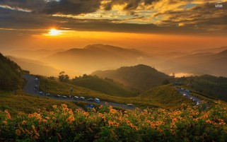 Peaks Flowers Road Cars Sunset wallpapers and stock photos
