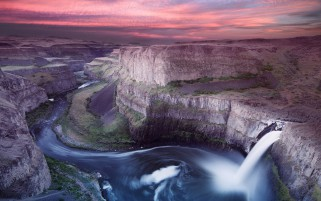 Waterfall Cliff River Pink Sky wallpapers and stock photos