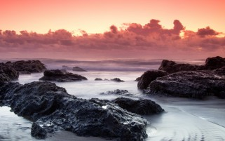 Red Clouds Ocean Black Rocks wallpapers and stock photos