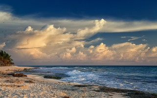 Pretty Ocean Calm Beach Clouds wallpapers and stock photos
