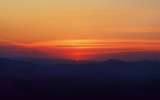 Amazing Orange Sky Dark Hills wallpapers and stock photos