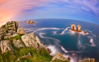 Ocean Rocks Cliff Grass Sky wallpapers and stock photos