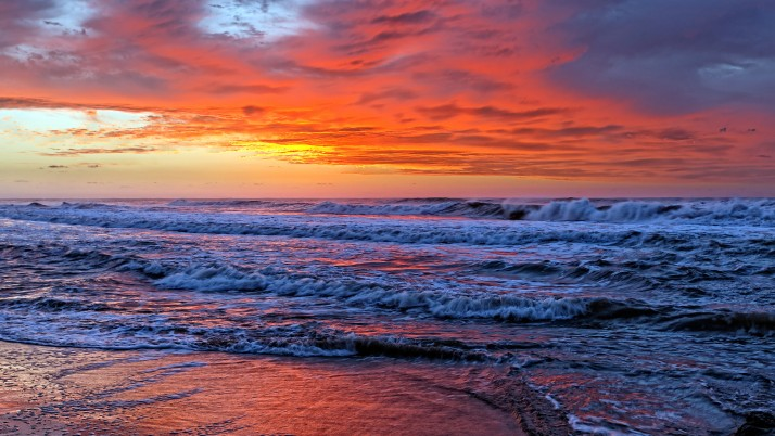 Fantastic Ocean Puesta del sol anaranjada wallpapers and stock photos