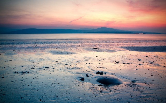 Calm Ocean Beach Pink Sky wallpapers and stock photos