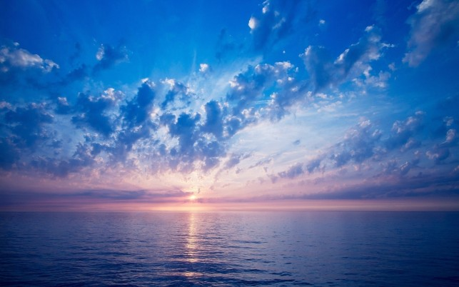 Calm Ocean Clouds Pink Horizon wallpapers and stock photos