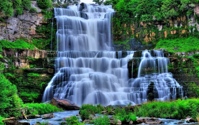 Waterfall Cascade Mossy Cliffs wallpapers and stock photos