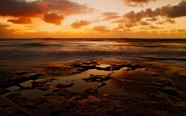 Wild Ocean Rocks Orange Sky wallpapers and stock photos
