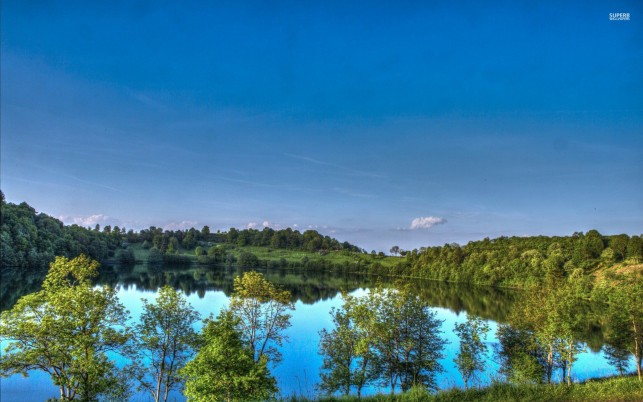 Pretty Blue Lake Green Trees wallpapers and stock photos