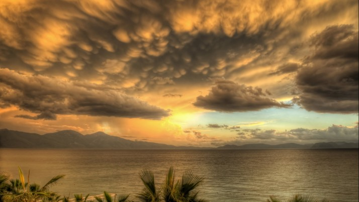 Ocean Gray Clouds Orange Sunny wallpapers and stock photos