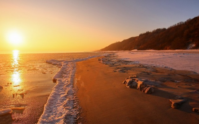 Foamy Ocean Beach Hill Sunset wallpapers and stock photos