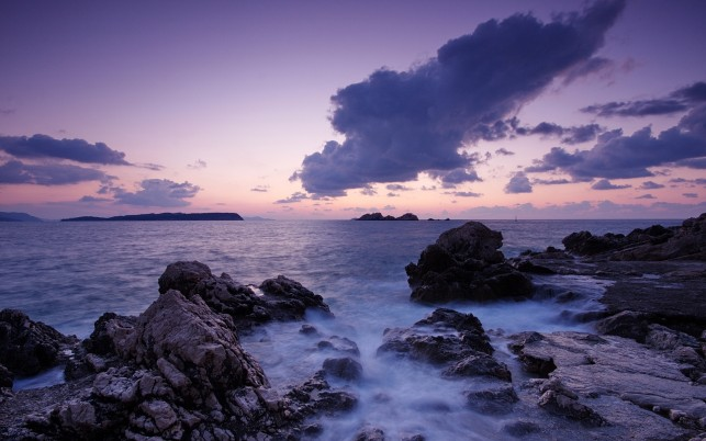 Ocean Pretty Rocks Purple Sky wallpapers and stock photos