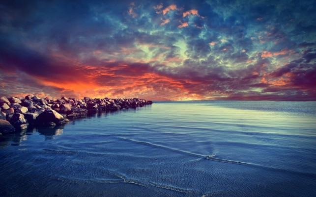 Stunning Ocean Rocks Red Sky wallpapers and stock photos