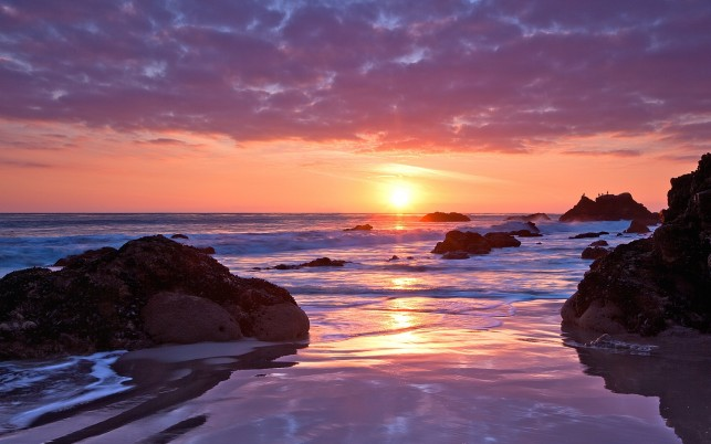 Ocean Rocks Beach Pink Sunset wallpapers and stock photos