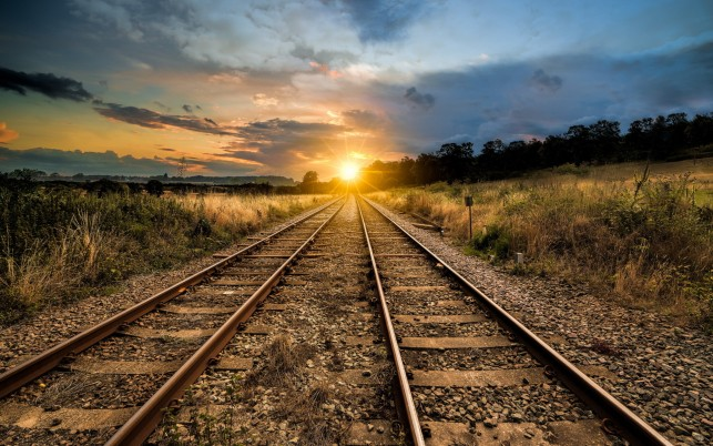 Double Tracks Bright Sunrise wallpapers and stock photos