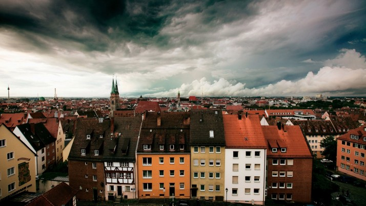 Stormy clouds above the city wallpapers and stock photos