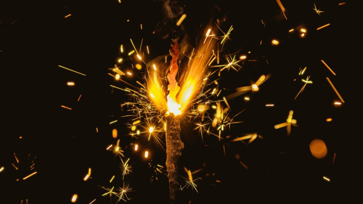 Fire Sparks Glitter Dark Backg wallpapers and stock photos