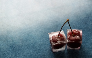 Cherries in ice wallpapers and stock photos