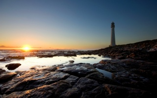Sunset at lighthouse wallpapers and stock photos
