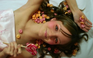 Cute girl and candies wallpapers and stock photos