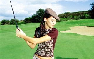 Woman playing golf wallpapers and stock photos