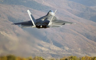 F22 over hills wallpapers and stock photos