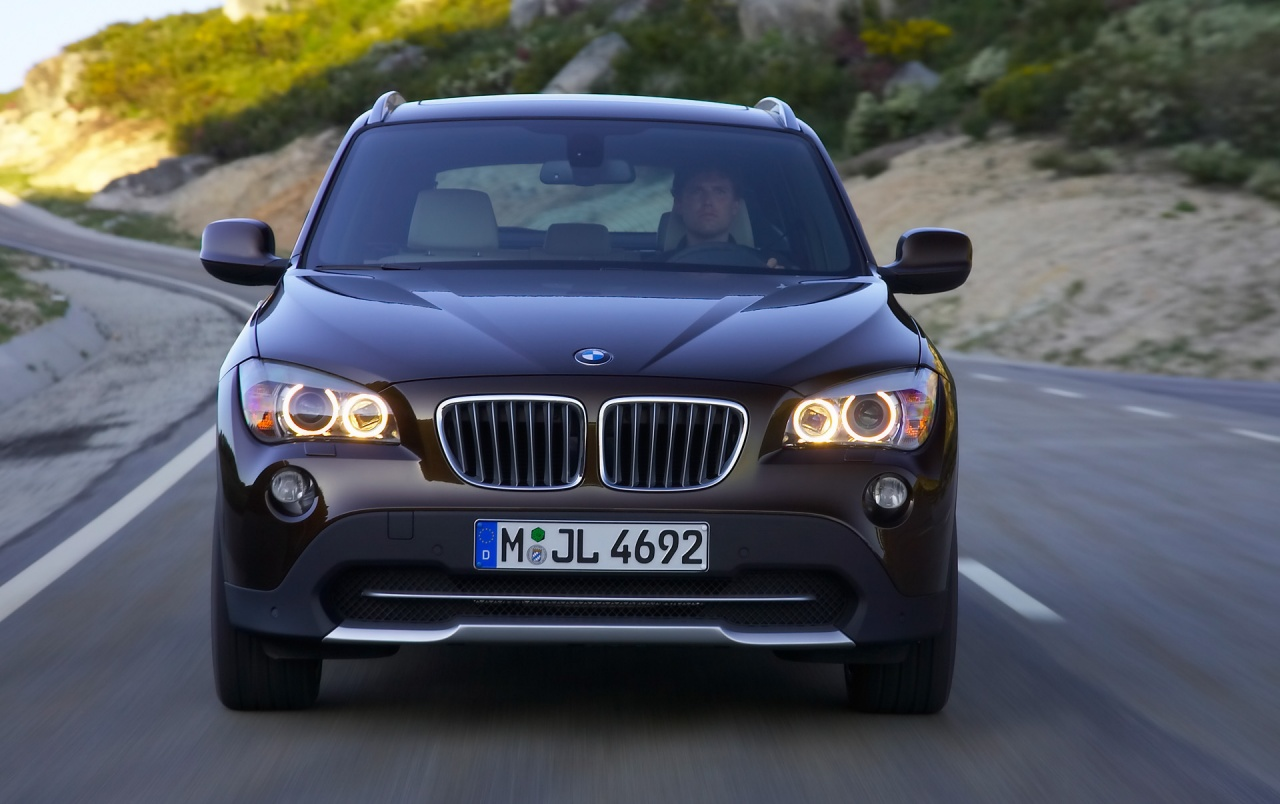 Bmw X1 Front Speed Brown 2 Wallpapers Bmw X1 Front Speed Brown 2 Stock Photos