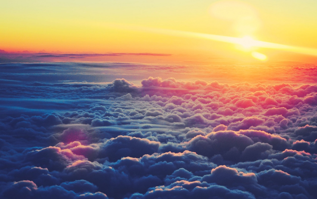 Sunrise Above the Clouds wallpapers
