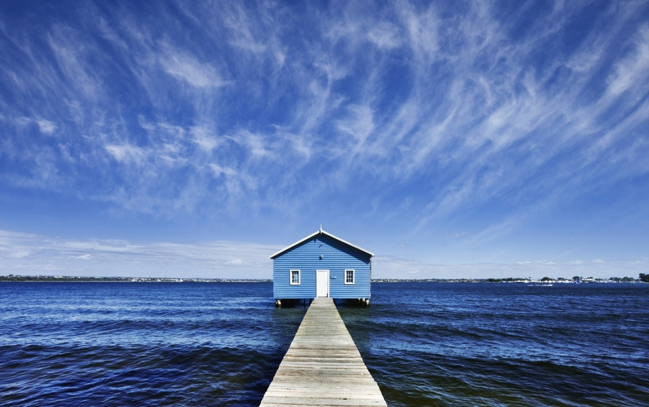 Blue pier house wallpapers blue pier house stock photos for Blue wallpaper for home