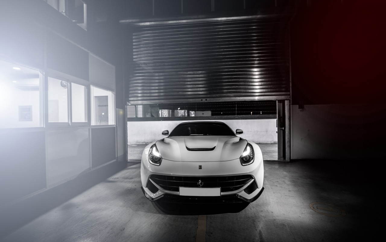 White Ferrari F12 Berlinetta Wallpapers White Ferrari F12 Berlinetta Stock Photos