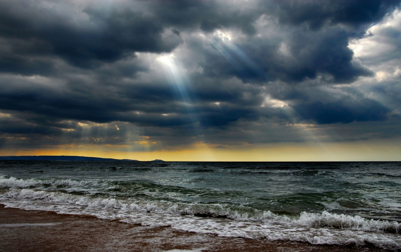 Ocean Stormy Clouds Sun Rays wallpapers